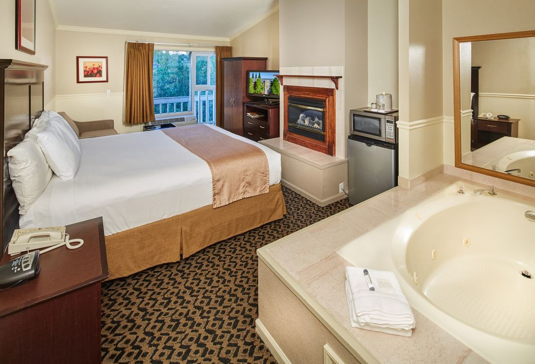 King bed with fire place and whirlpool tub